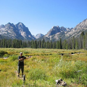 Arline greets the Sawtooth Mountains.